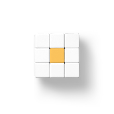 Ein Rubik Würfel mit leichtem Schatten frontal von oben fotografiert. Alle